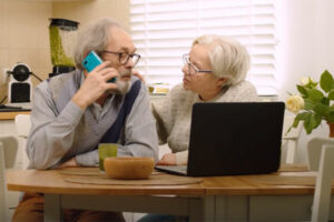 Older couple talking on phone about federal retirement